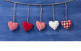 Fabric hearts on wooden background — Stock Photo