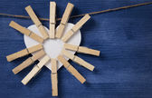 Many clothespins on paper heart — Stock Photo