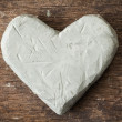 Clay heart on wooden surface — Foto Stock