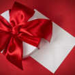Background with gift box and envelope — Stock Photo