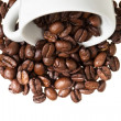 Inverted coffe cup with beans — Stock Photo