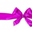 Purple tied bow from ribbon - Stock Photo