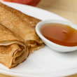 Russian crepes with honey — Stock Photo