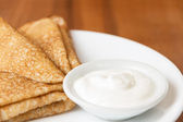 Russian crepes with sour cream — Stock Photo