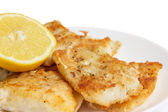 Fried in flour codfish on plate — Stock Photo