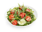 Salad from ruccola, cherry tomatoes and cucumber — Stock Photo