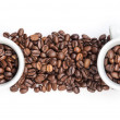 Heap of coffee beans with two cups — Stock Photo