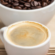 Royalty-Free Stock Photo: Espresso in a cup and cup full of beans