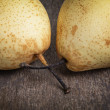 Two asian pears on old wooden table — Stock Photo