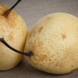 Two asian pears on burlap — Stock Photo