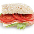 Big sandwich with salami cheese tomato and salad leaves on ciabatta bread — Stock Photo