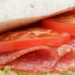 Italian sandwich with salami — Stock Photo