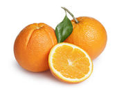 Ripe round oranges with half, stem and leaf — Stock Photo