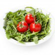 Ruccola and tomatoes in white bowl — Stock Photo