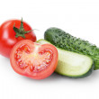 Sliced tomato and cucumber — Stock Photo