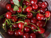 Ripe cherries with stem and leaves — Stock Photo