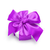 Cylinder gift box with ornate ribbon bow — Foto de Stock