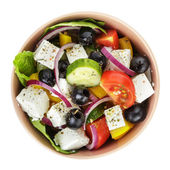 Fresh greek salad in clay bowl — Stock Photo