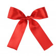 Red festive tied bow made from ribbon — Stock Photo #30556243