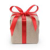 Liten present box wraped i återvunnet papper med band rosett — Stockfoto