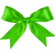 Green festive tied bow made from ribbon — Stock Photo