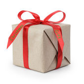 Small gift box wraped in recycled paper with ribbon bow — Stock Photo