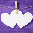 Two paper hearts hanging on rope — Stockfoto