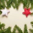 Fir branches on old paper with decorations — Stock Photo