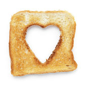 Toasted slice of white bread with hole heart shape — Stock Photo
