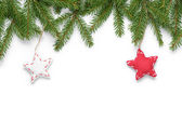 Border from fir twigs with stars — Stock Photo