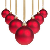Red christmas balls hanging on ribbon v shape — Stockfoto