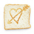 Slice of bread with heart and arrow — Zdjęcie stockowe