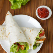 Wheat tortilla with chicken and vegetables — Stock Photo #34638533