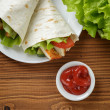 Wheat tortilla with chicken and vegetables — Stock Photo #34638539