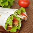 Wheat tortilla with chicken and vegetables — Stock Photo