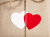 Two paper hearts together — Stockfoto