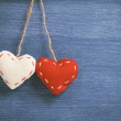 Decorative hearts hanging on the rope against blue wood wall — Stock Photo