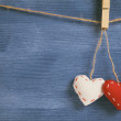 Decorative hearts hanging on the rope against blue wood wall — Photo