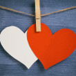 Decorative hearts hanging on the rope against blue wood wall — Foto Stock