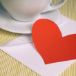 Valentine card on table with envelope and cup of coffee — Stock Photo