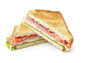 Toasted sandwich with ham, cheese and vegetables — Stock Photo