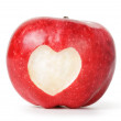 Heart carved on an red apple — Stock Photo