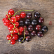 Stock Photo: Organic garden berries on old wood table