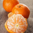 Ripe tangerines closeup photo on wooden table — Stock Photo #38084941