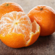 Ripe tangerines closeup photo on wooden table — Stock Photo