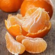 Ripe tangerines closeup photo on wooden table — Stock Photo #38084981