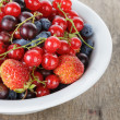 Fresh garden berries in bowl — Stock Photo