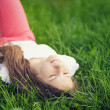 Young teenage girl resting on grass — Stock Photo #38484391