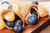 Homemade blinis or crepes with blueberries and jam — Stock Photo