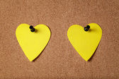 Heart shape sticky notes on cork board — Stock Photo